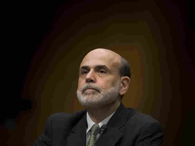 Fed Reserve Chair Ben Bernanke listens at a hearing in December on his nomination for another term.