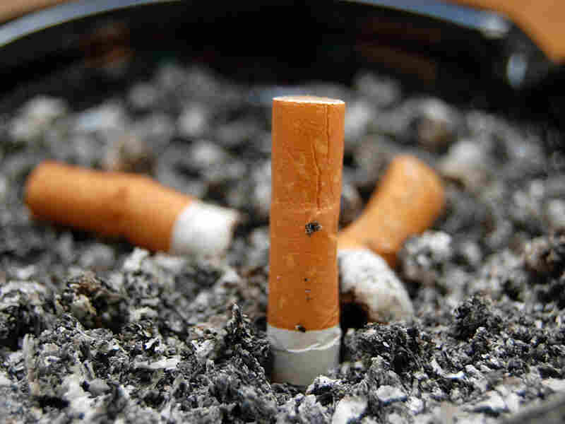 Cigarette butts in an ashtray.