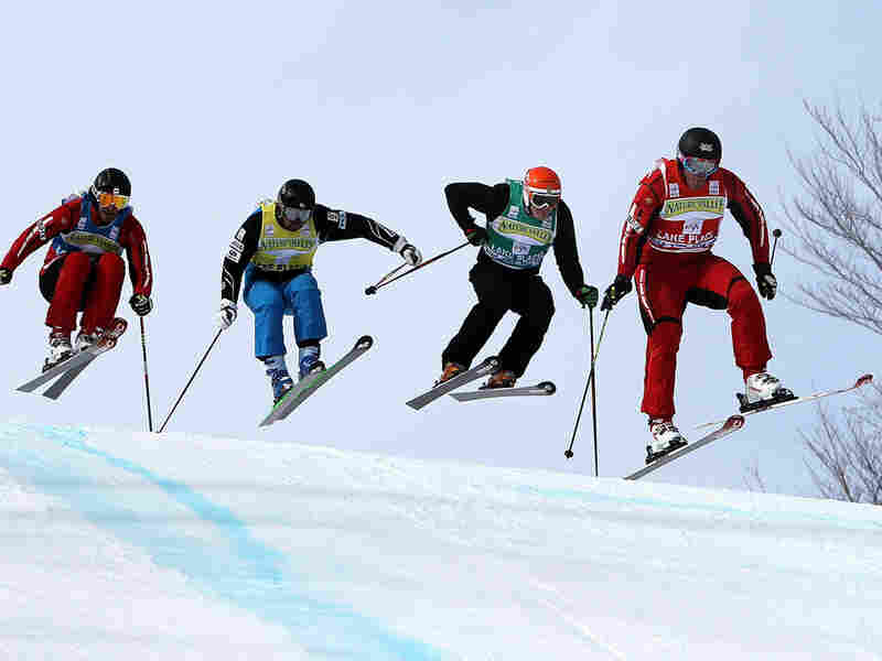 Christopher Delbosco (right) of Canada leads a pack of skiers.