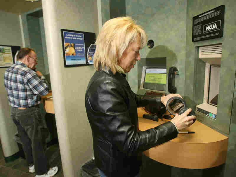 Barbara Hegeman deposits checks