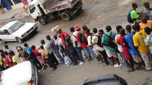 Haitians line up for free food at Muncheez in Petionville, Haiti