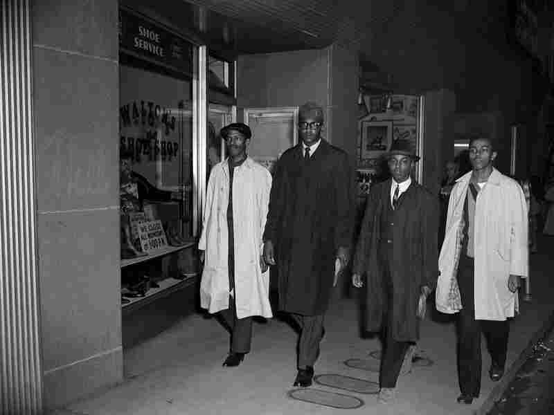 The four participants in the Woolworth's lunch counter sit-in walk down the street.