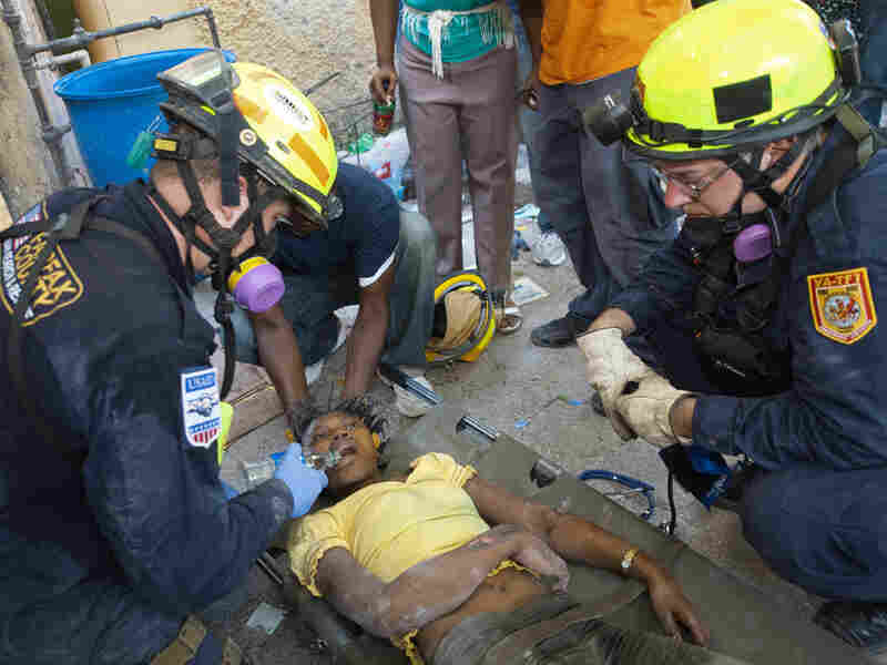 Fairfax County Urban Search and Rescue tend to a student they dug out of the rubble in Haiti.