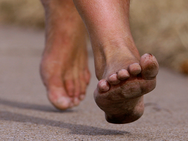 A barefooted runner takes to the streets.