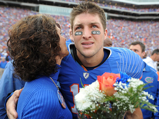 University of Florida quarterback Tim Tebow embraces his mother, Pam, during a November 2009 pre-game ceremony before an NCAA college football game against Florida State. The two are set to appear in a controversial anti-abortion ad that will air during the Super Bowl.