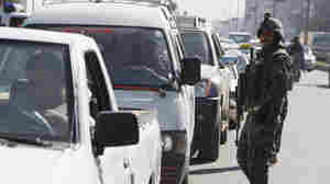 Iraqi security forces monitor traffic