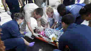 U.S. military personnel prepared to airlift an injured girl to an offshore medical facility.