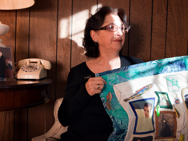 Lorenza Colletti holds a quilt she made to honor her son Marc, who drowned in 1995 at age 26. In Marc's memory, Lorenza and her husband Joseph now sponsor an annual field trip for New York middle-schoolers to learn about marine life and the environment.