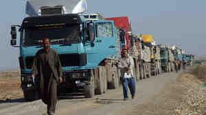 Trucks from Iran queue for inspection outside the Iraqi city of Amara