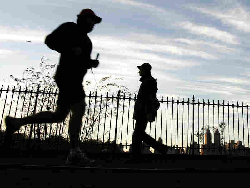 Runners take the jogging path around the Central Park reservoir