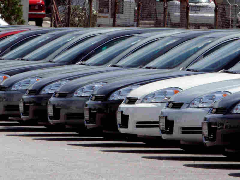Cars in a dealer lot.