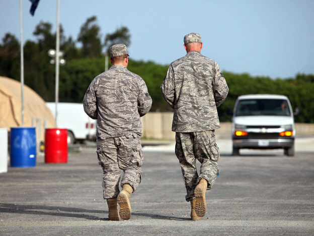 U.S. troops walk the grounds of the Camp Justice compound, the site of the U.S. war crimes tribunal, at Guantanamo Bay, Cuba, in 2009. A bipartisan group of nine senators has proposed legislation that would require accused Sept. 11 terrorists to be tried in military courts. (AP)