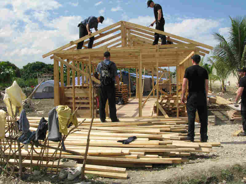 Canadian sailors build temporary structures at the Christian School and Orphanage of Leogane, Haiti