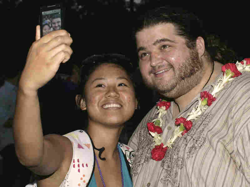 Actor Jorge Garcia snaps a picture with Gemma Datuin at ABC's 'Lost' premiere