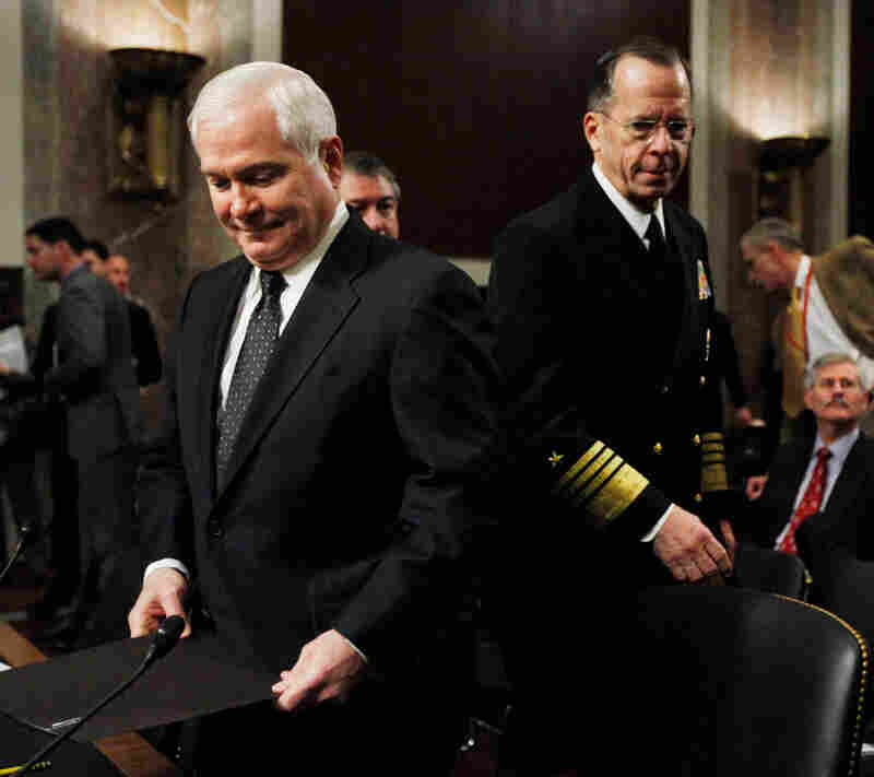 Robert Gates (left) and Michael Mullen arrive on Capitol Hill in Washington.