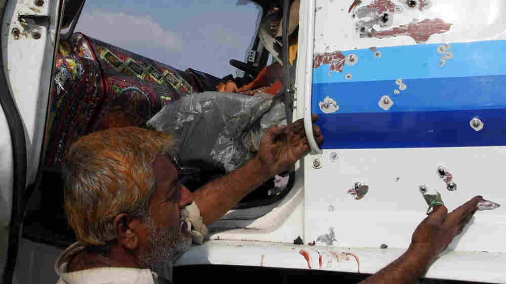 A Pakistani truck driver demonstrates the danger of driving supplies out of Pakistan.