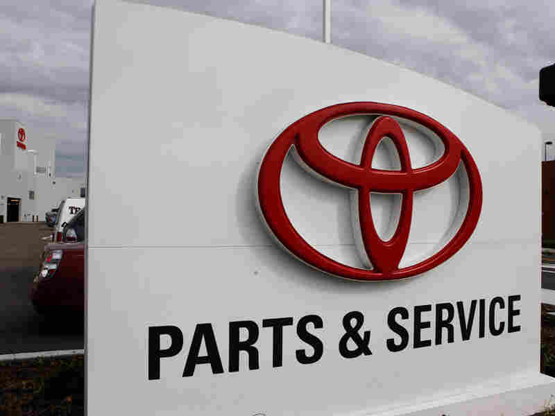 A sign for the parts and service department at a new Toyota dealership
