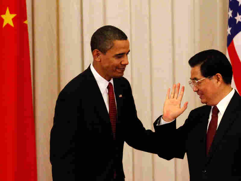 Chinese President Hu Jintao gestures to President Obama after a joint press conference