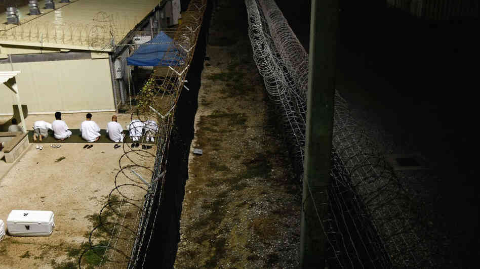 Detainees pray at the the U.S. military prison in Guantanamo Bay,