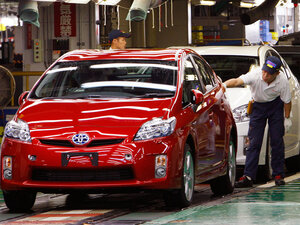 A worker gives examines a 2010 Prius at a Toyota plant in Japan.
