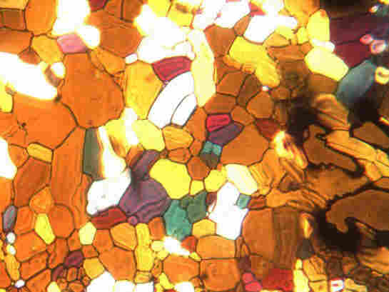 A thin (0.1 mm) layer of water that is frozen and examined under polarized light.