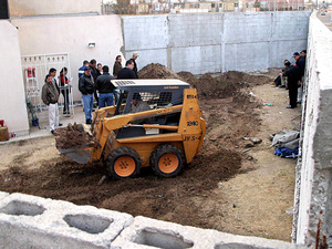 Members of  the Federal Agency of Investigations excavate the yard at the House of  Death.