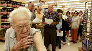 Pete Jacksen, 86, waits in line to get a flu shot at Pavilions pharmacy in Monrovia, Calif.