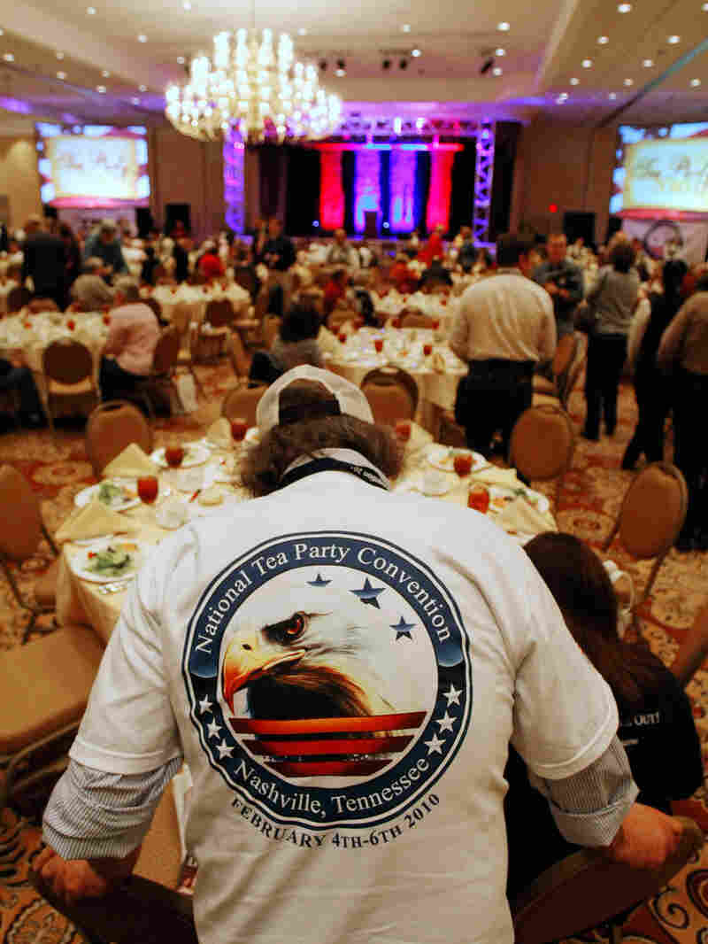 A man wears a National Tea Party Convention shirt.