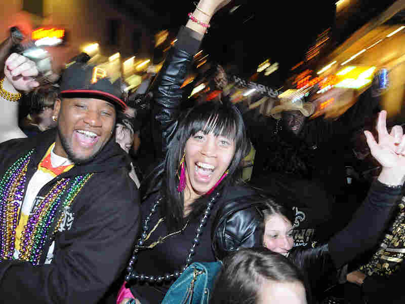 Fans celebrate the New Orleans Saints' win against the Indianapolis Colts.
