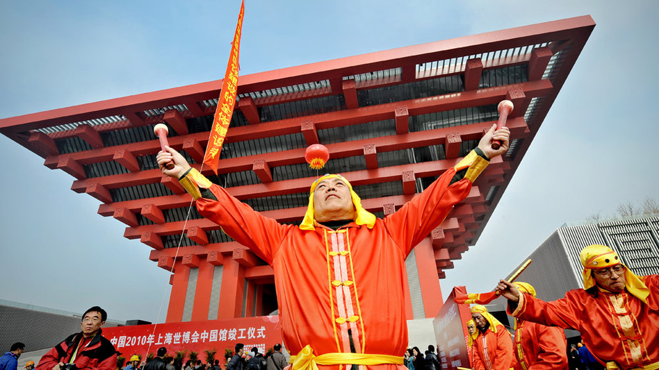 Chinese performers beat drums during a ceremony in January, marking the completion of the Chinese pavilion at the site of the 2010 World Expo  in Shanghai.