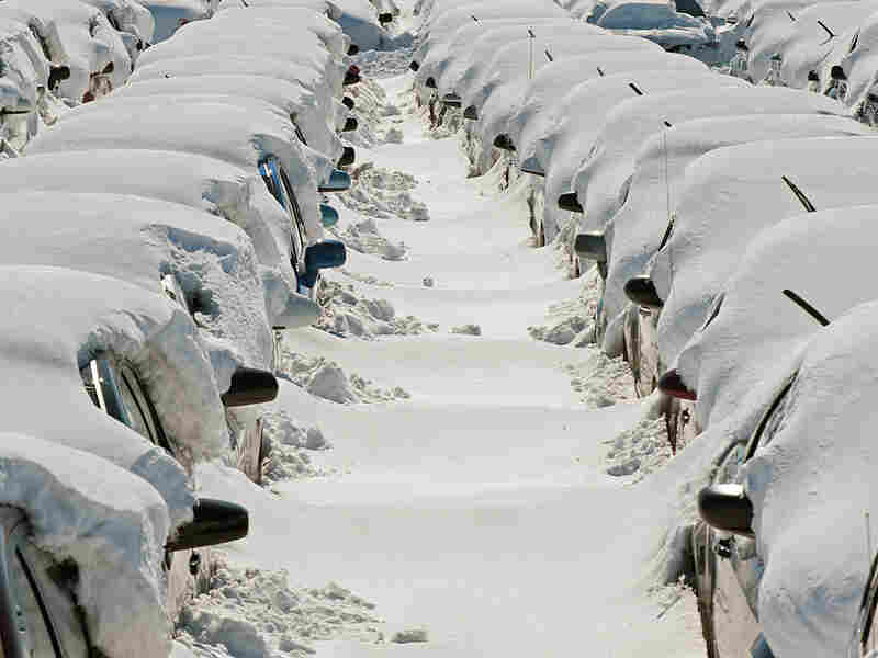 Cars wait to be dug out at Dulles International Airport, one of Washington's two main airports.