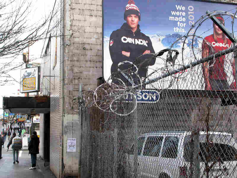 A billboard pitches exclusive Canada-brand Olympic fashions in Vancouver's Downtown Eastside.
