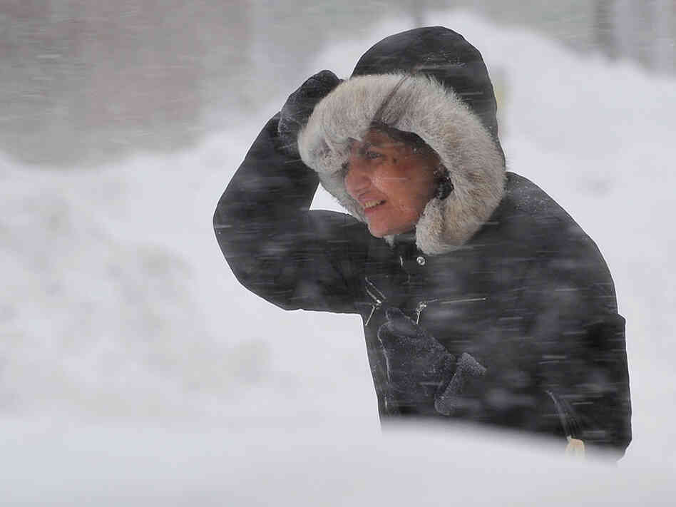 A woman struggles through a blizzard in Washington, DC