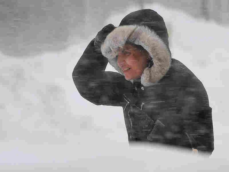 A woman struggles through a blizzard in Washington, DC