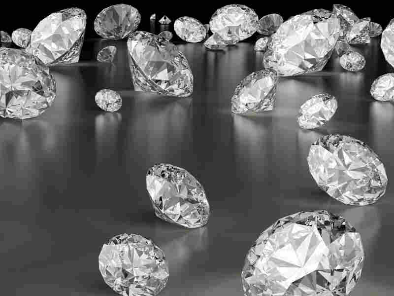 A variety of diamonds scattered on a table.
