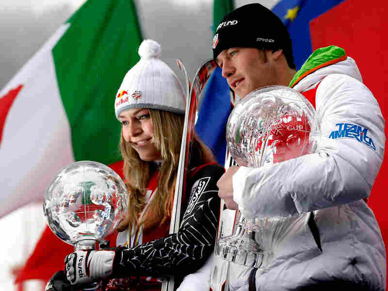 Lindsey Vonn and Bode Miller pose after winning the overall globes at the FIS Alpine Ski World Cup
