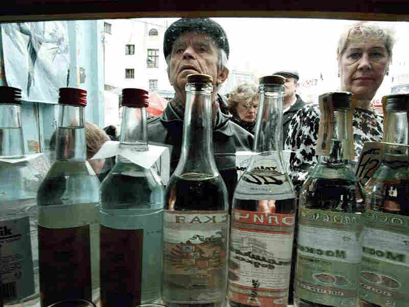 Russians purchase vodka from a street kiosk in Moscow.