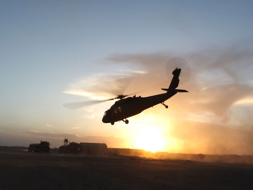 A U.S. Army Black Hawk helicopter takes off at a forward operating base in Afghanistan.