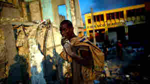 Looting continues in downtown Port-au-Prince.