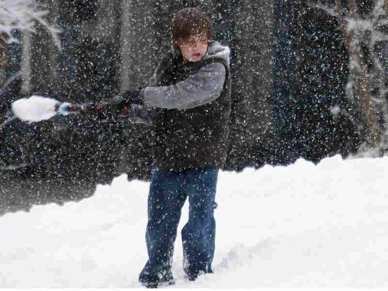 Dylan Smith, 10, of Jackson, Miss., swings a bat
