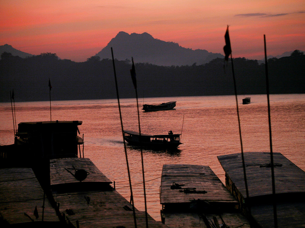 Sun sets over the Mekong River in Luang Prabang, Laos