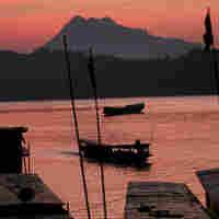 Sun sets over the Mekong River in Luang Prabang, Laos
