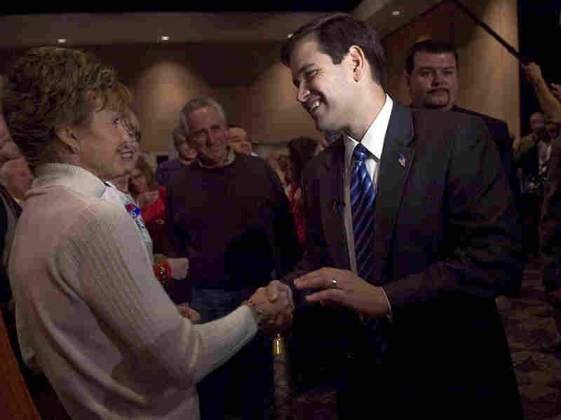 Republican Senate candidate Marco Rubio shakes hands with supporters.