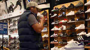 A man shopping for sneakers in a store