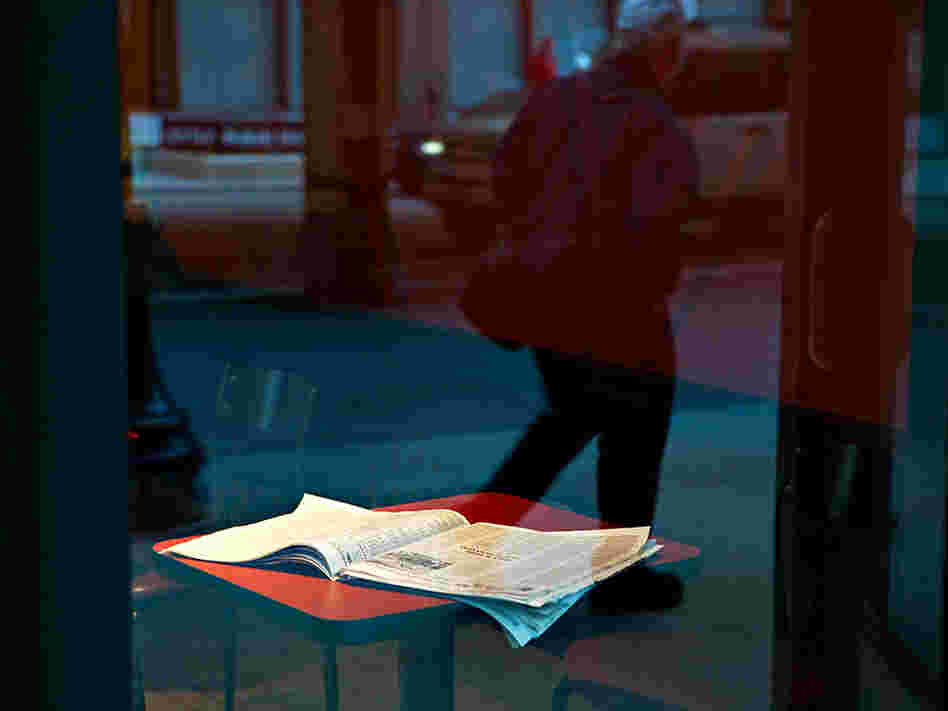An open newspaper on a cafe table