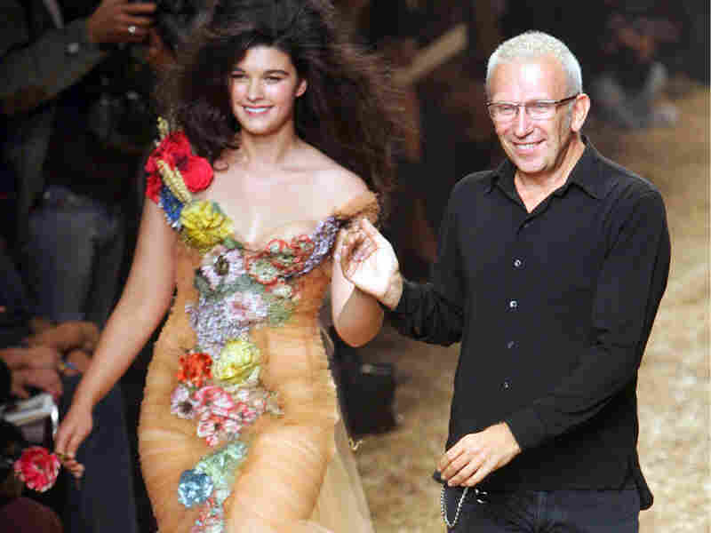 French fashion designer Jean-Paul Gaultier takes the catwalk with plus-size model Crystal Renn.