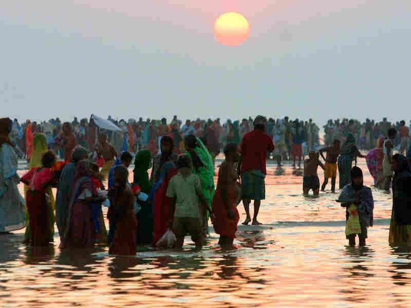 In this file photo from Jan. 14, 2008, Hindu devotees wade on Sagar Island.