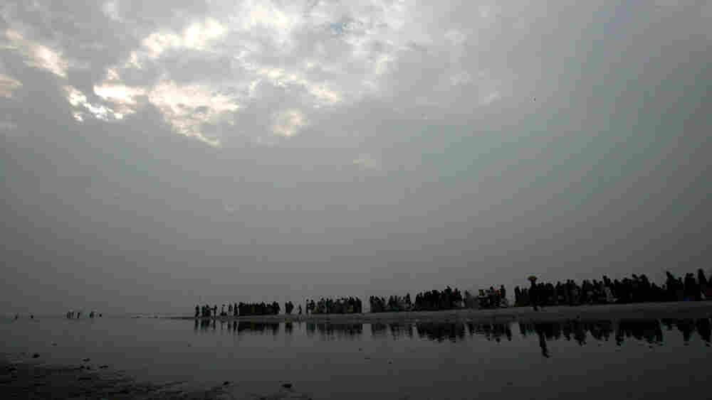 Pilgrims take a holy dip at a lagoon on Sagar Island