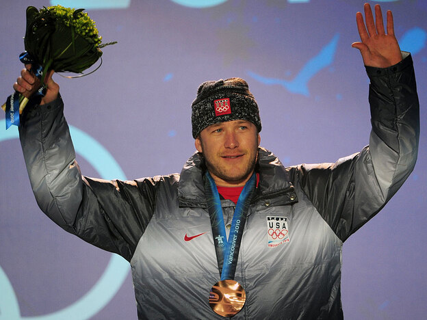 Alpine skier Bode Miller of the United States won a bronze medal in the men's downhill race Monday during the Vancouver Winter Olympics. Miller, who performed poorly at the Torino Games, is approaching these games with a new attitude.