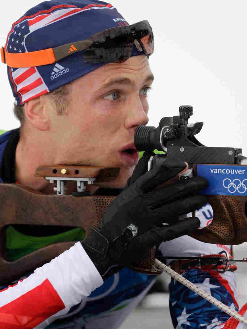 Tim Burke of the U.S. men's biathlon team aims his rifle.
